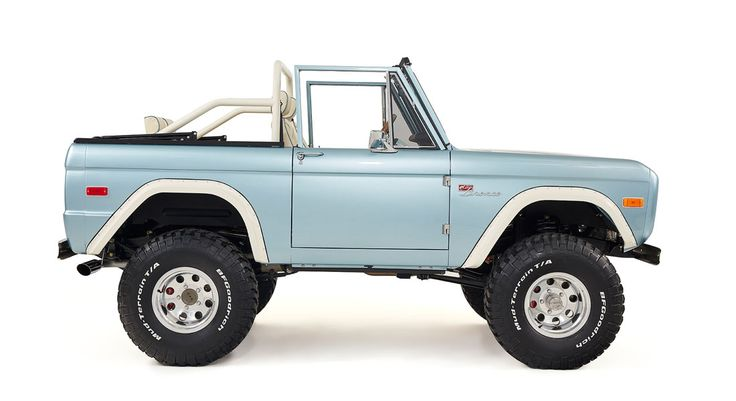 """A 1974 Ford Bronco with ginormous 35"""" BFG Mud-Terrain tires, and Holley fuel-injected, Ford 347 Stroker motor that'll get 'em rolling."""