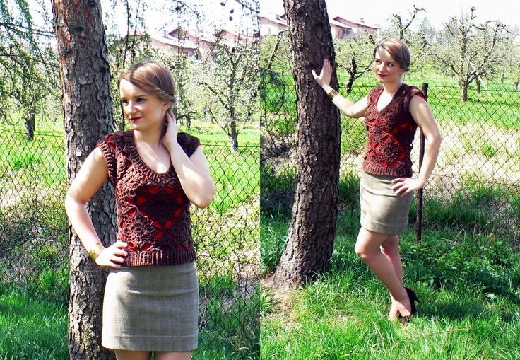 Brown crochet vest with quadrilateral elements.