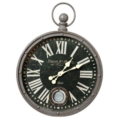 A Classy Metal Wall Clock Designed To Look Like A Old Fashion Stopwatch Complete With A