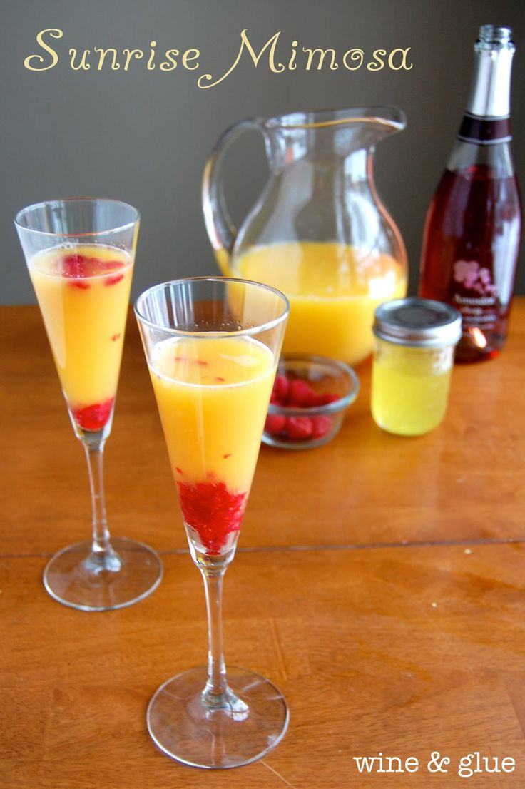 Sunrise Mimosa | www.wineandglue.com | Made with raspberries and orange simple syrup, this mimosa is sinfully delicious!