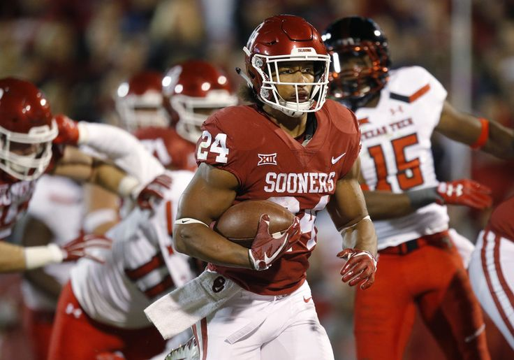 Oklahoma's Rodney Anderson (24) runs for a touchdown during a college football game between the Oklahoma Sooners (OU) and the University of Texas Tech Red Raiders (TTU) at Gaylord Family-Oklahoma Memorial Stadium in Norman, Okla., Saturday, Oct. 28, 2017. Photo by Bryan Terry, The Oklahoman