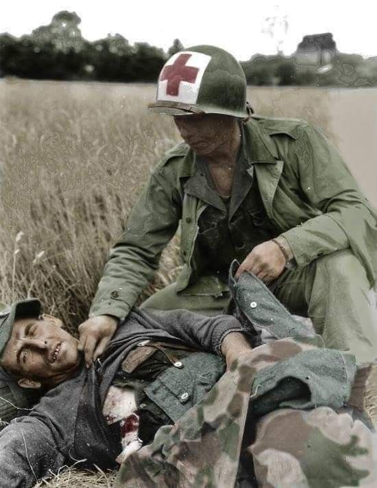 An American medical personnel attends a wounded German