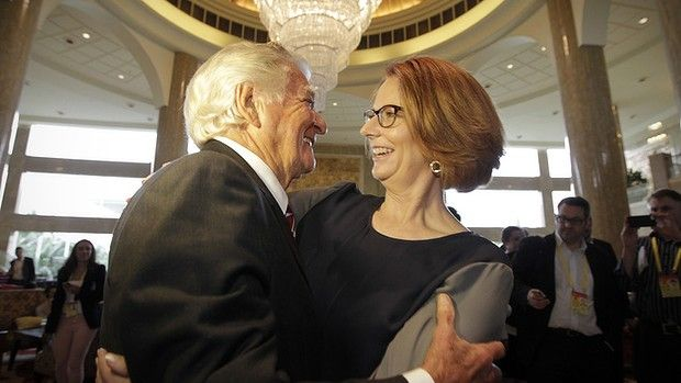 Julia Gillard embraces Bob Hawke at the Boao Forum in Hainan, China.