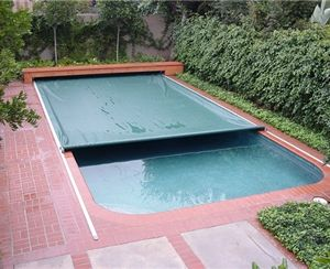 pool auto cover. hidden under bench seat. Top of bench lifts for east maintenance.