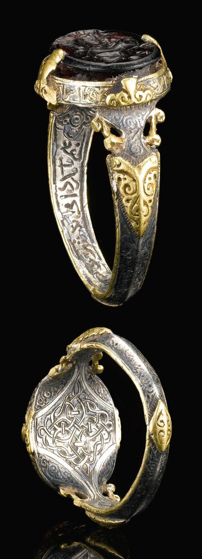 Seljuk ring; silver and gold set with a deep purple stone seal bearing the name of Ali Ibin Yusuf | Seal on ring probably datable to the 8th/9th century, it was mounted on a ring late, ca 12th century | 27'500£ ~ sold (Apr '14) Seljuk bir halka oluşturduğu; | Gümüş ve altın Ali Ibin Yusuf adını taşıyan derin bir mor taş mühür seti 8 / 9. yüzyıla tarihlenen muhtemelen halka damga, bu geç bir halka üzerine monte edilmiş ca 12. yüzyıl | ~ Satılan 27'500 £ (Nisan '14) 12s