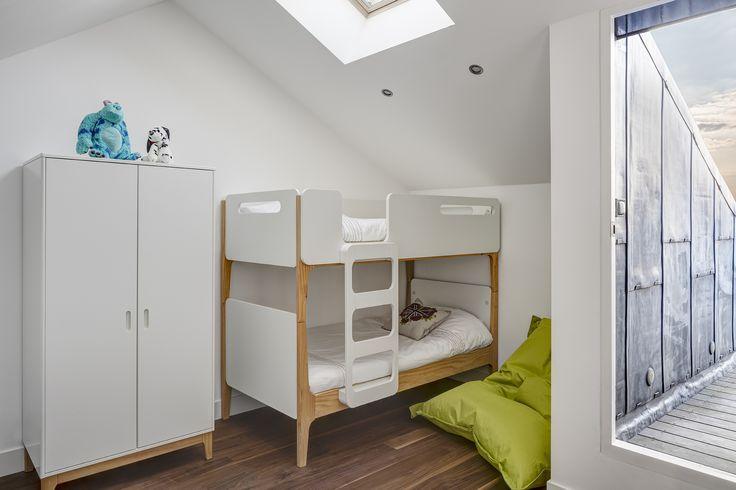 Kids loft apartment bedroom. White on white.