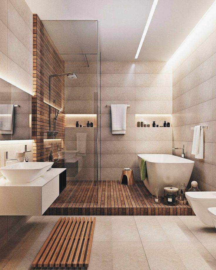 Dusche ist in der Nähe der Badewanne. Anstelle der Toilette einen Handtuchhalter. Unter der