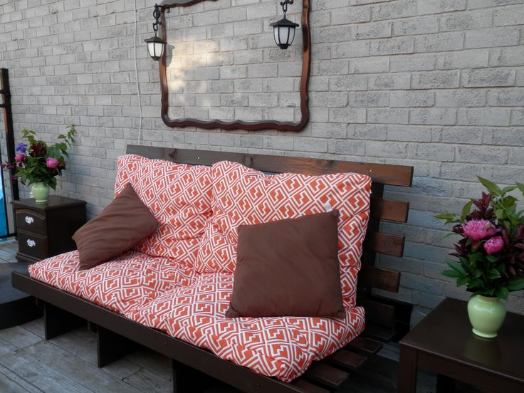A garage sale find! Queen sized futon raised up for an outdoor couch. But cushions were ...