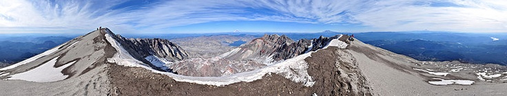360° panorama from the summit of Mount St. Helens as seen on an early-October afternoon. In the foreground is the ice-covered crater rim. Visible in the lower center is the lava dome. Steam rises from several dome vents. Above the dome, in the upper center, lies Mount Rainier and Spirit Lake. Mount Adams appears to the right of Rainier on the horizon as well as Mount Hood and Mount Jefferson on the far right.