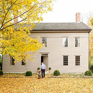 Colonial-style homes usually stand two or three stories high with narrow clapboard siding (sometimes brick), a high-pitched roof, one or more dormers, a massive chimney, and multipane windows. Colonials feature narrow, windowless, wooden doors. For historically accurate color, choose painted earth tones such as ochre, red, or brown.