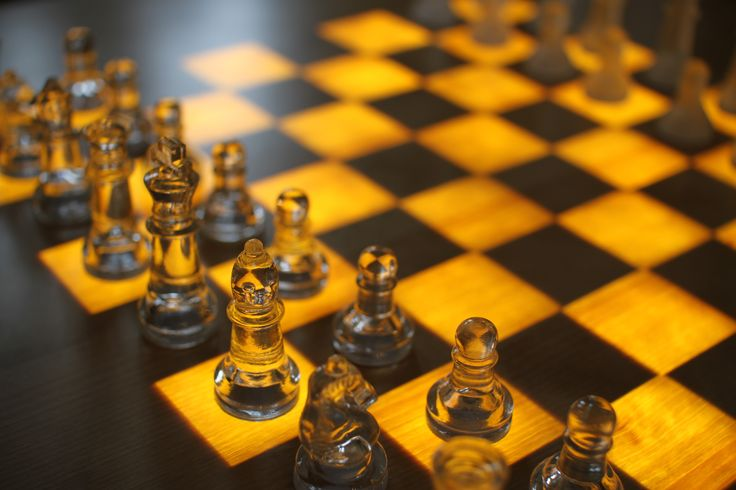 Glass chess pieces on The Scandinavian Chess Table