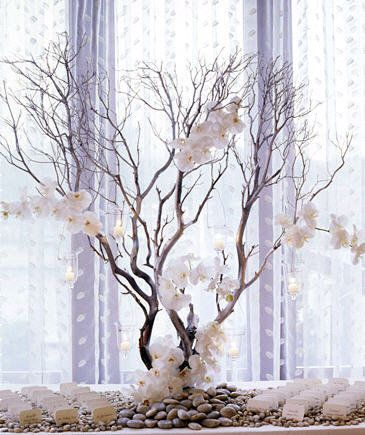 manzanita branches can make for a dramatic arrangement on the place card table! Imagine this in brighter colors, with dark branches.