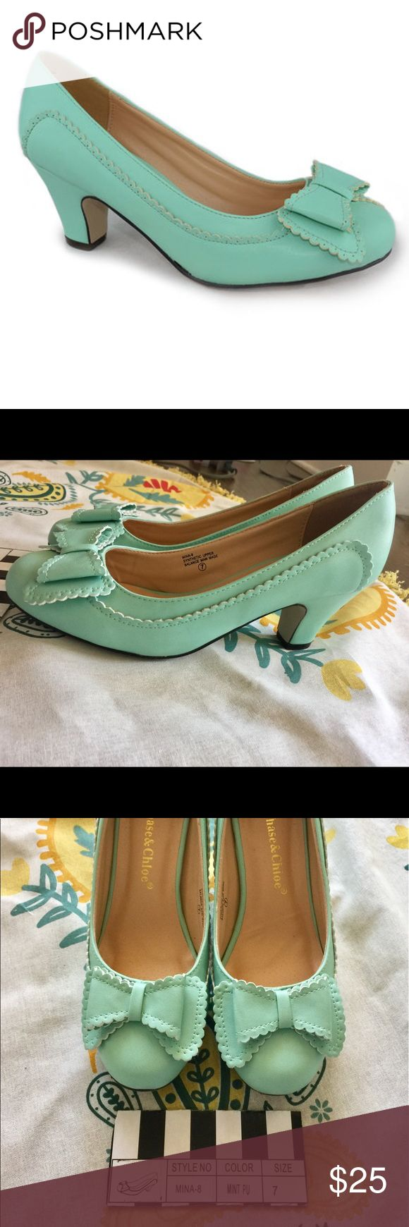 Mina Mint Pump with bow A T-strap buckle secures this pair with an adjustable fit, while a chunky heel offers a stable boost of height to your high-fashion ensembles. Note: these were worn twice.   2.5'' heel Buckle closure Man-made Imported Chase & Chloe  Shoes Heels