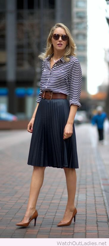 Amazing navy pleated midi skirt with a nice shirt and a brown belt