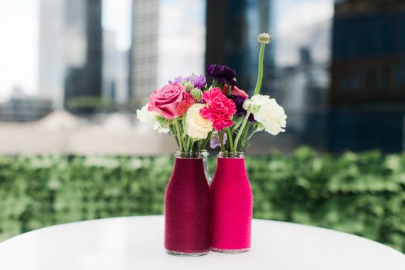 Yarn wrapped vases by The Colour Curator. Perfect little vessel to hold flowers at your wedding, garden party or even on your kitchen table!  Contact directly for customised designs. Instagram @thecolourcurator.   Photograph www.juliaarchibald.com  Flowers www.undertheivy.com.au