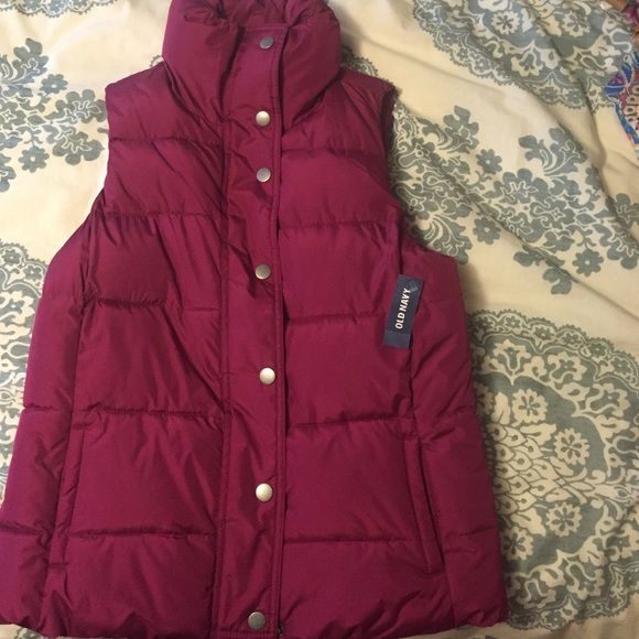 Old Nacy puffer vest. NTW. magenta. Size S Never worn. Magenta puffy vest from old navy. Very warm-soft inside lining. Two pockets on front. Bought wrong size last season and forgot to return. Awesome vest! Has buttons and a zipper. Old Navy Jackets & Coats Vests