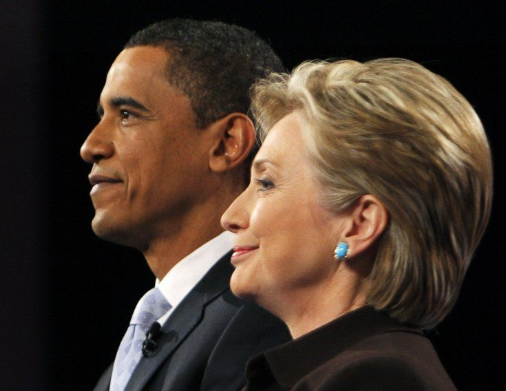 Then US Democratic presidential candidates Barack Obama and Hillary Clinton pose for photographers prior to the CNN/Los Angeles Times Democratic presidential debate in Hollywood, California January 31, 2008.