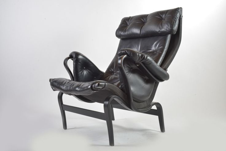 Pair of black leather Pernilla lounge chairs by Bruno Mathsson for Dux