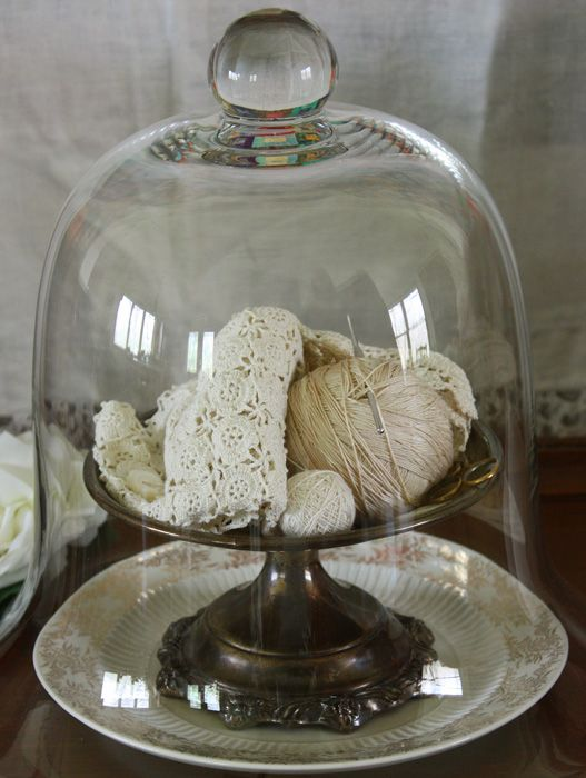 yarn in glass. Watson you are brilliant! This gives me the answer to the problem. I wanted to put out A's dome in the living room for his cakes along with a fruit bowl but I wasn't sure about what to do when he hasn't made any cake. I can just stick decorations in it!