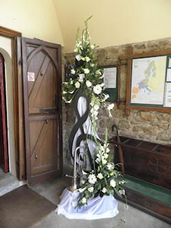 Flower arrangement in entrance to the church - flower and music festival