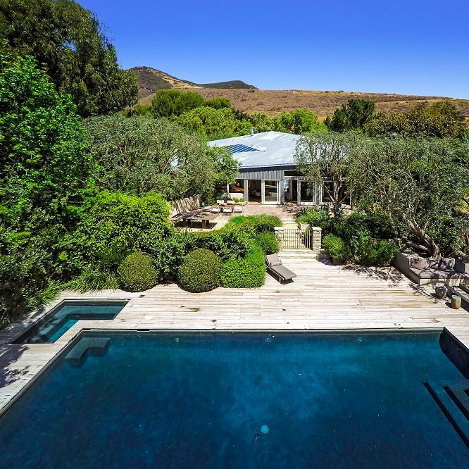 An overhead look at the pool and main house on this Frank Gehry-designed modern estate in Malibu, California that's owned by actor Patrick Dempsey. Credit: Brett Lawyer of Hilton & Hyland