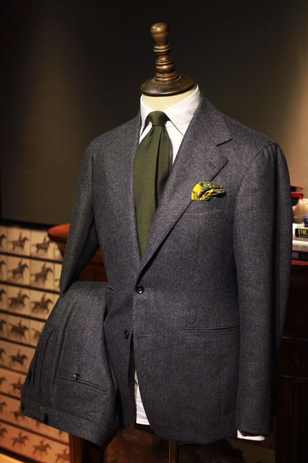 Italian grey flannel suit with green silk tie and kerchief.  Just the daywear for Draco.  Yum.