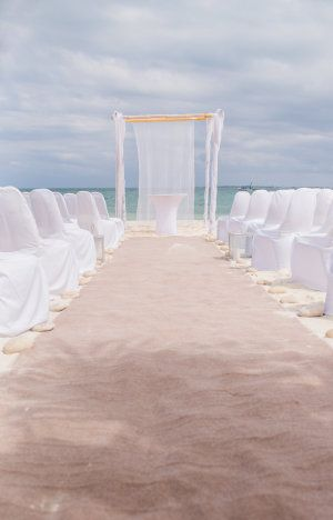 Elegant beach ceremony: http://www.stylemepretty.com/little-black-book-blog/2015/08/27/tropical-elegant-mexico-beach-wedding/ | Photography: Meg Miller - http://megmillerphotography.com/