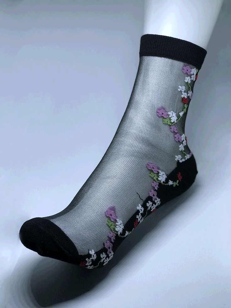 Women nylon flower designs (red, pink and white) with small green vine, black cotton bottom.