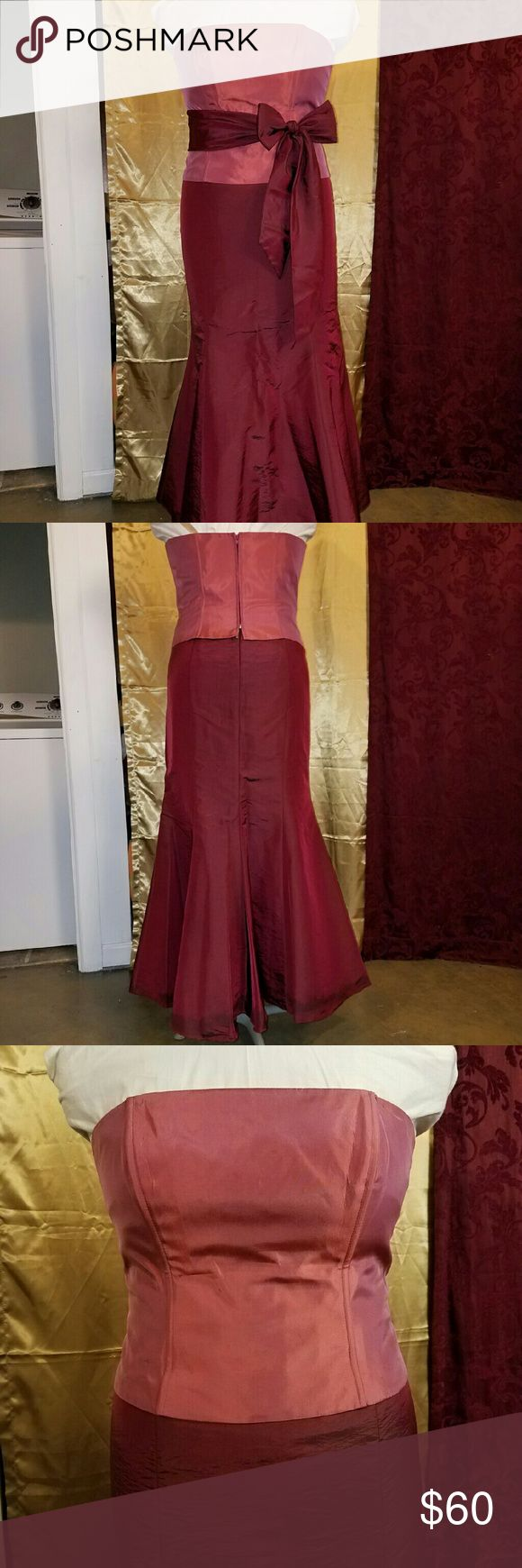 Size 16 David's Bridal two-piece dress Size 16 David's Bridal two-piece bridesmaid's dress. Garnet/cranberry skirt and sash, rose-colored bodice with light boning. Tulle in underskirt. All pieces are satin. David's Bridal Dresses Prom