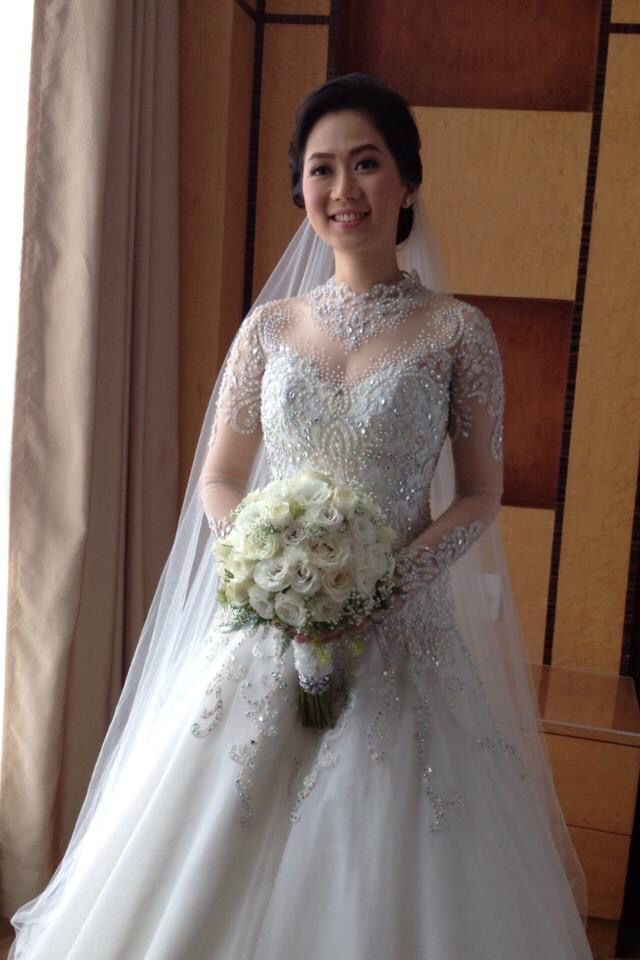 By Philippine wedding gown atelier Cecilio Abad.