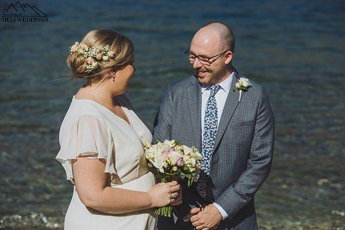 Bride and Groom exchange vows at Sunshine bay wedding, destination wedding ceremony, lakeside wedding Queenstown