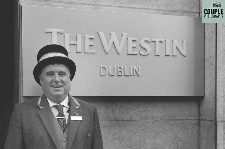 The concierge under the nameplate at the Westin by http:www.couple.ie