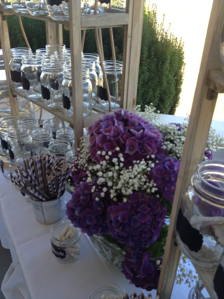 purple themed bridal shower%0A Mason jars with chalk labels set up on old looking shelves for a  refreshment drink station