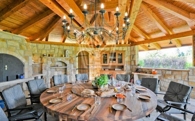 Outdoor stone kitchen - outdoor dining in a garden