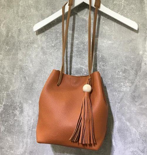 Small Tan Leather Look Tassel Handle Bucket Bag. Shop www.pinkcadillac.co.uk