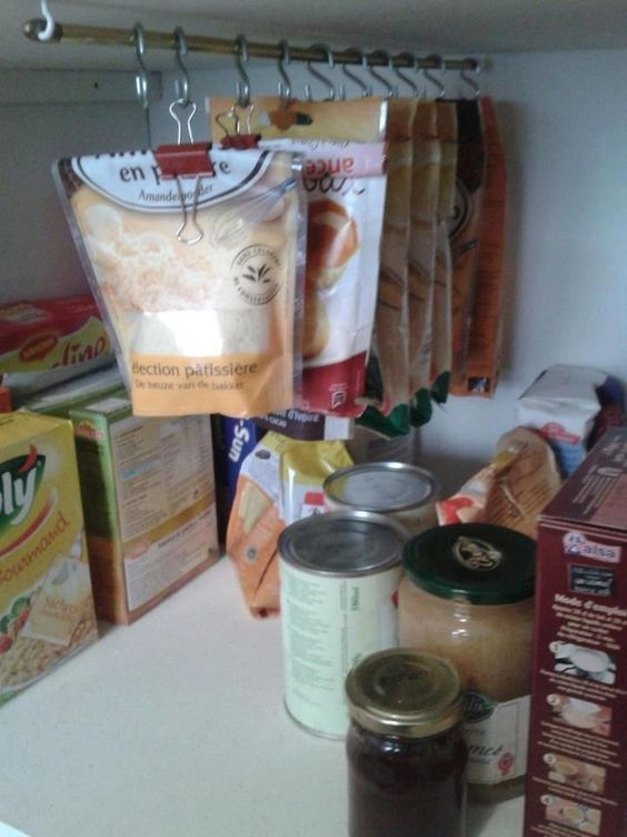 10 brilliant ways to use tension rods - hang bags in pantry with s hooks and binder clips for more shelf space.