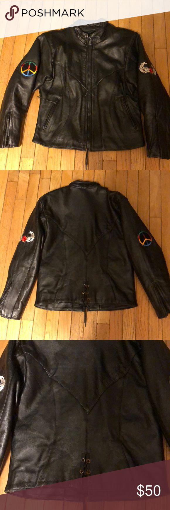 """Genuine Leather Black Leather Biker Jacket M Peace Genuine Leather Black Leather Biker / Motorcycle Jacket. Heavy Duty, fully lined, lacing detail in back, zippers at sleeves, zipper to add an extra lining (although it's extremely heavy already), Patches (peace & wings) professionally sewn on each sleeve by a Leather seamstress. Full zip up. There is no tag for size, but it fits like a medium. In good pre-owned condition. Measures about 19"""" from armpit-armpit, 23.5"""" from shoulder-hem, 21""""…"""