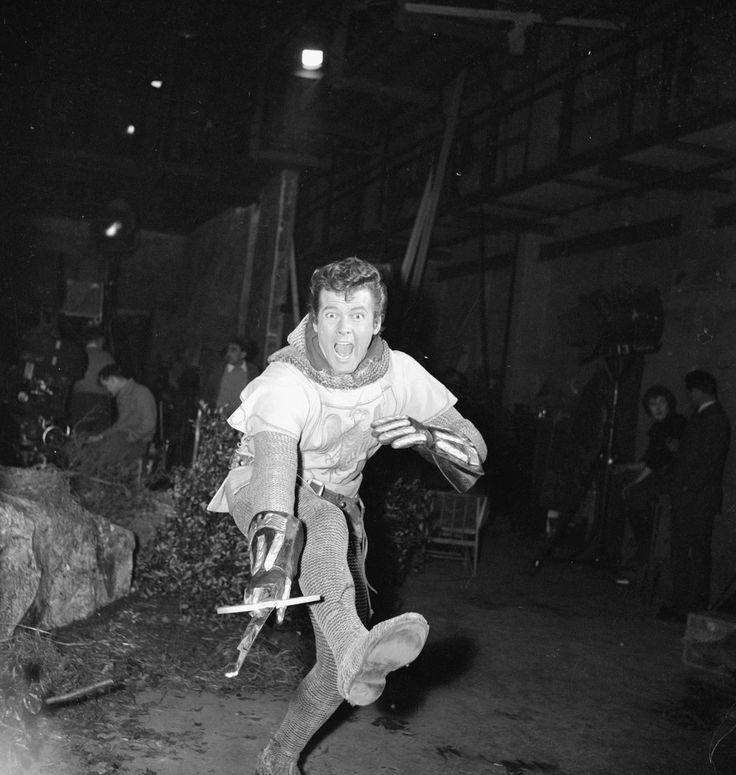 Roger Moore between camera shots for Ivanhoe. February 1958.