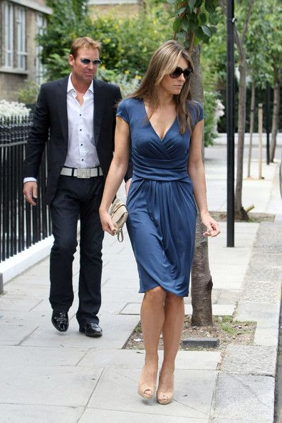 Is Liz Hurley copying Kate Middleton's style? The British model steps out in a figure-hugging navy dress - reminiscent of the Duchess of Cam...