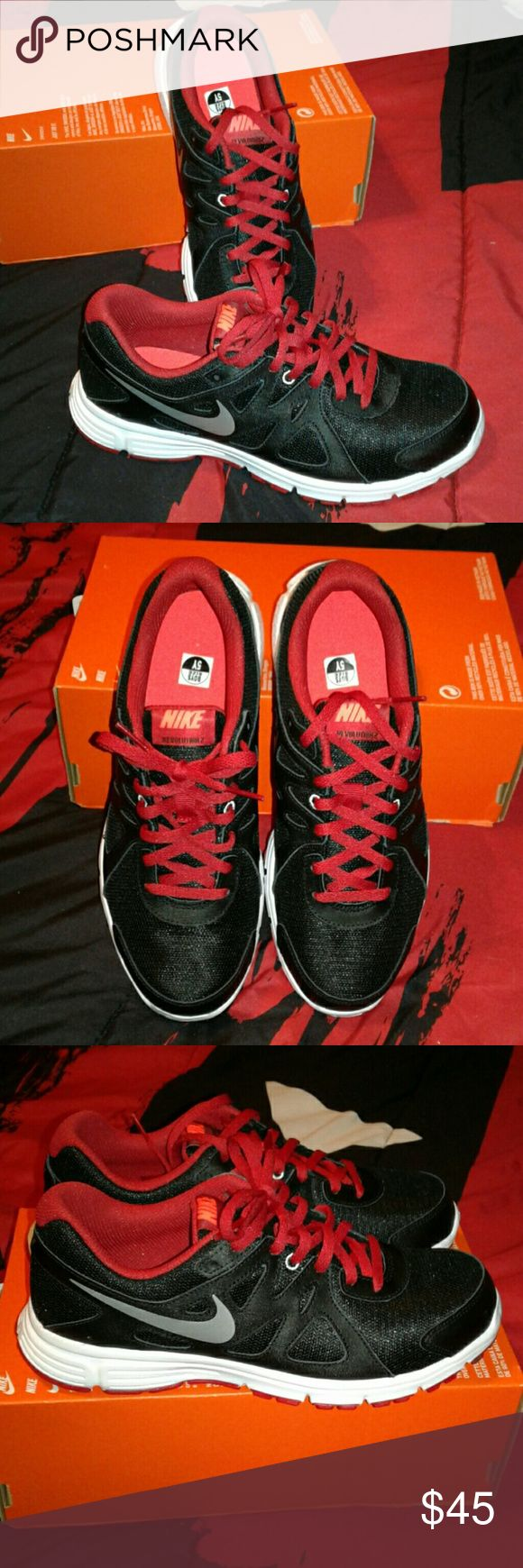 NWT Nike Revolution 2 tennis NWT black and red NIKE Revolution 2 tennis shoes, youth size 5 which equals a women's size 6, great shoes for the gym! Will ship shoes in box without lid. Nike Shoes Sneakers