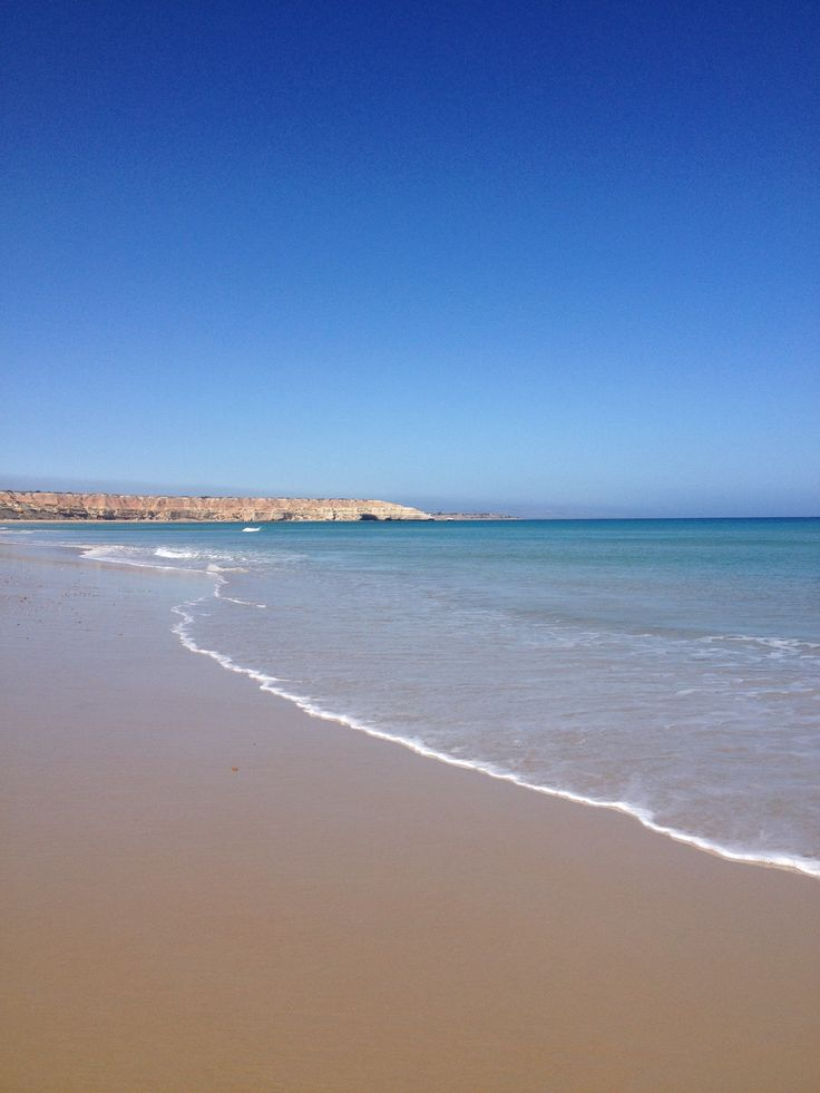 Maslin Beach. Massive beach, soft sand, mellow waves, clear water, and close to wine country.