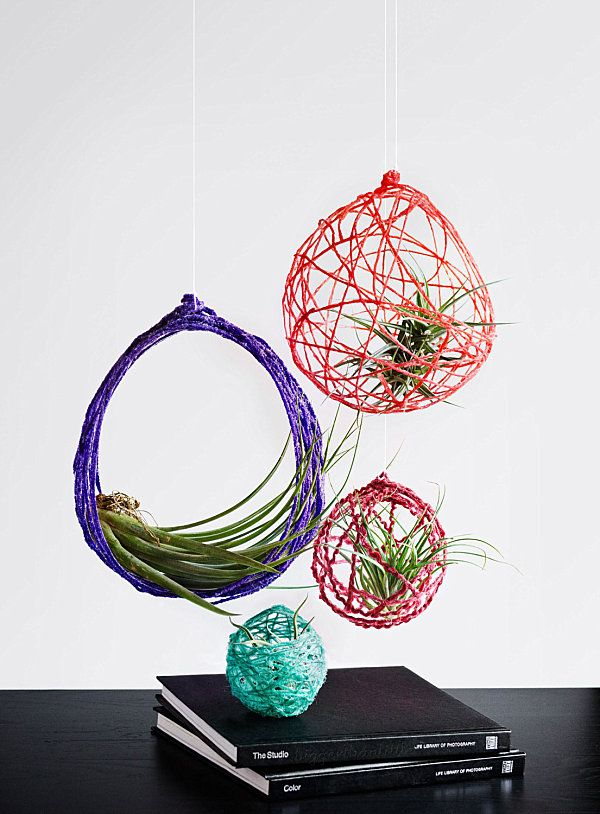 inspiration for air plant hanging! use this method: http://becado.blogspot.com/2011/09/some-diy-yarn-love.html  then spray with scotch guard. use light teal & white yarn