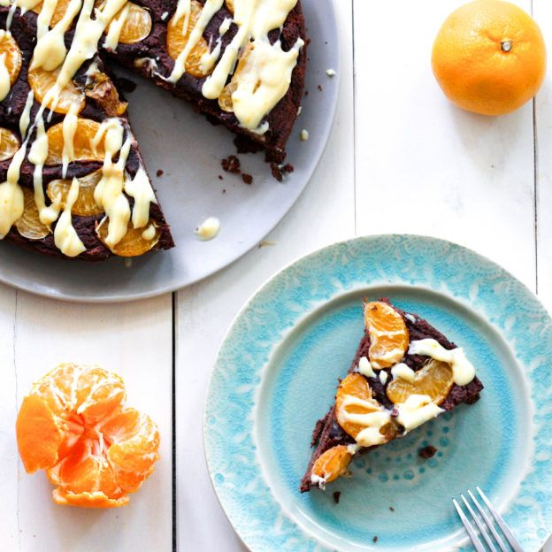 Celebrate clementine season with this Clementine Chocolate Paleo Cake, drizzled with coconut clementine glaze. Perfect for the holidays!