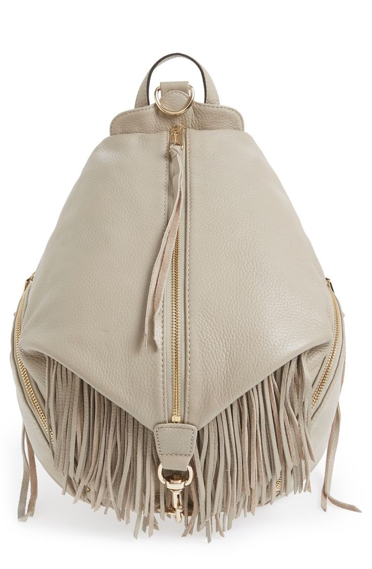 This campus-classic backpack goes glam in lavishly fringed leather for serious street-chic attitude.