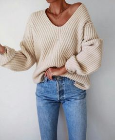 Simple look featuring a slouchy, relaxed sweater and jeans