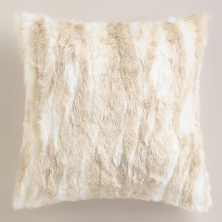 Our cream-colored, faux fur pillow lends a look of luxury to your space at an irresistibly affordable price. Chic stripes and soft backing create a neutral tone that effortlessly coordinates with existing decor.