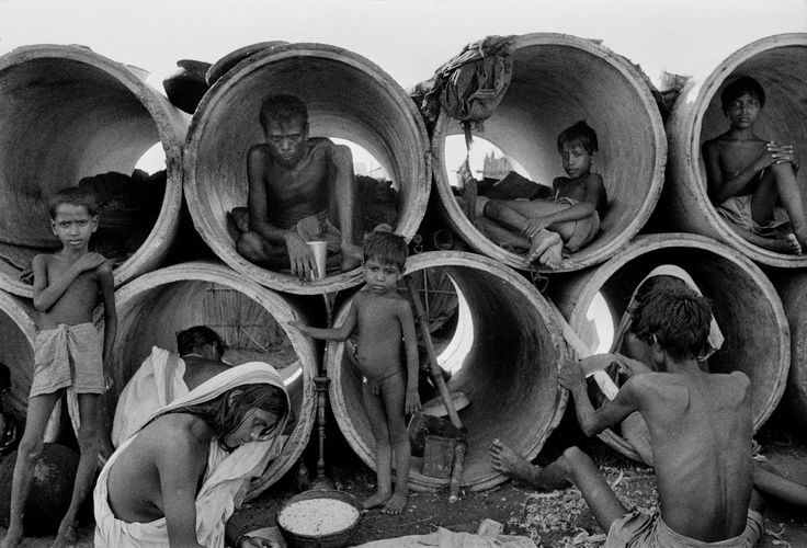 INDIA. 1971. Refugees transform tubes into homes in the city outskirts. © Bruno…