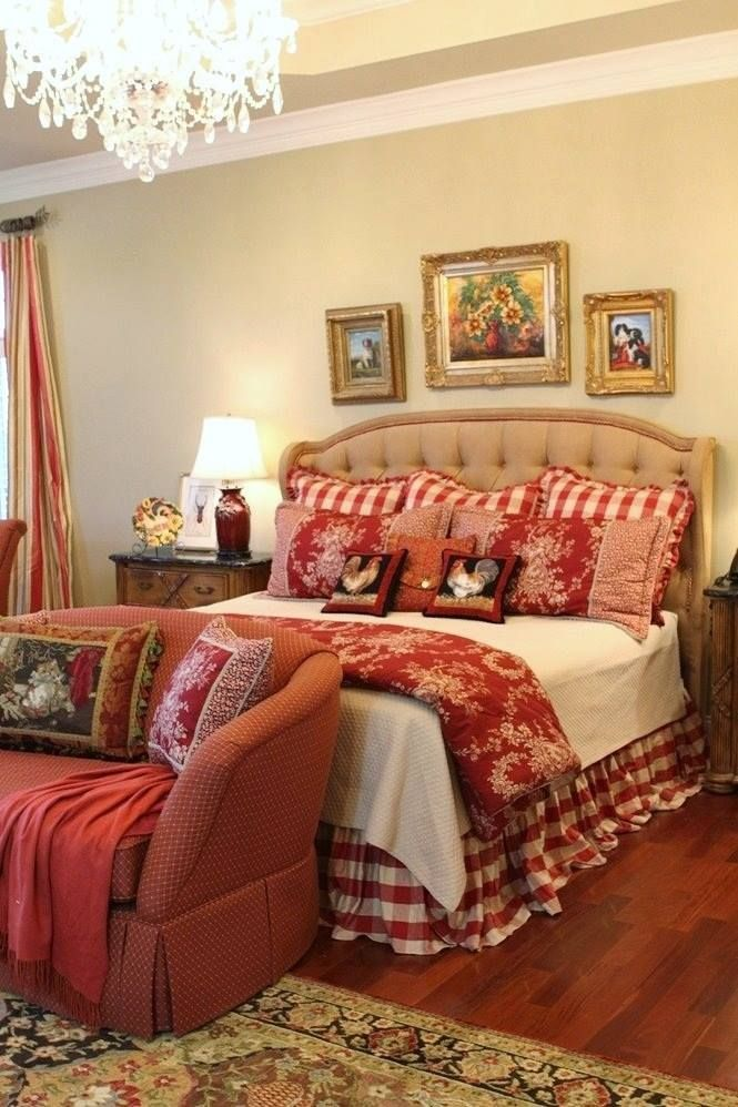 Love the red patterns and prints mixed in this Bedroom