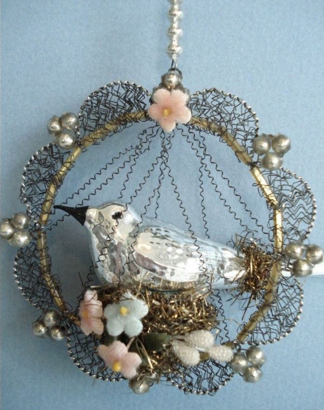 Antique Christmas ornament, silver mercury glass bird on a nest.