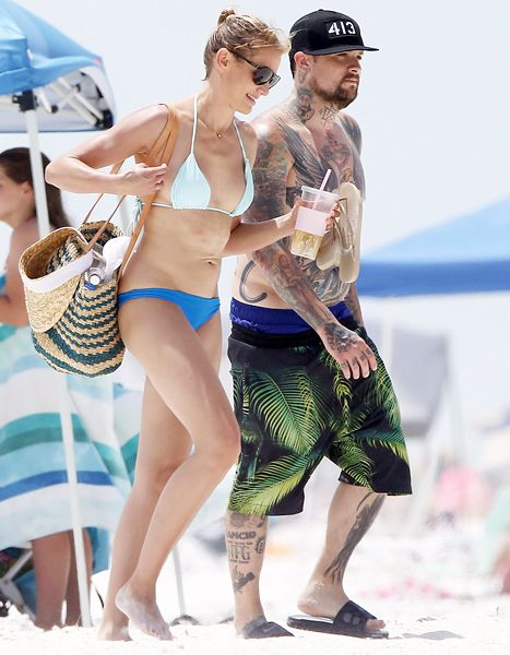 Splish, splash, and all kinds of sexy! Cameron Diaz and boyfriend Benji Madden took their steamy romance to Orlando over the holiday weekend. Diaz totally rocked cobalt blue bikini bottoms and a sky blue string top.